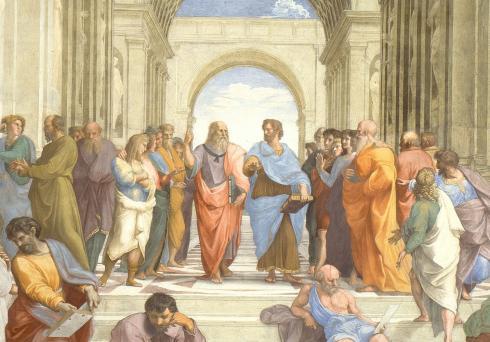 Plato en Aristoteles filosoferen in hun eigen taal (Rafaël: De school van Athene)